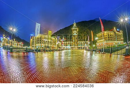 SOCHI, RUSSIA - APRIL 20, 2015: Evening panorama of the Rosa Khutor resort.
