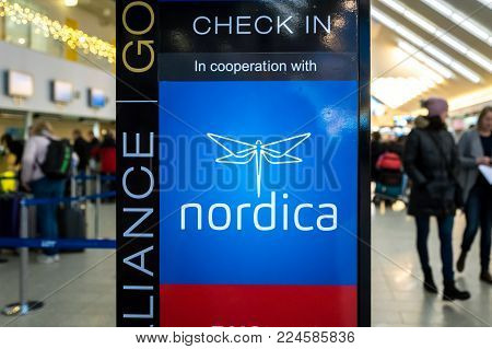 Tallinn, Estonia - January 2018: holding of Nordica, airline check-in counter at Tallinn Airport. Nordica is the state-owned Estonian flag carrier headquartered in Tallinn and based at Tallinn Airport.