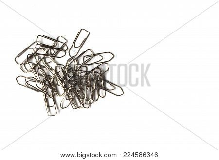 Paperclips on white background. Office and school supplies