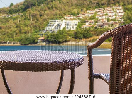 rattan chair on balcony hotel room with nature view