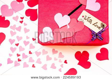 valentine's day holiday. red box for valentines with paper hearts and ribbon. valentine messages and gift cards