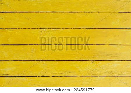 Yellow planks - wooden textured background. Rustic wall,  shabby timber wood board