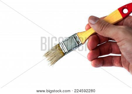 tassel in man's hand - isolated on white background photo.