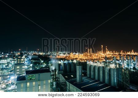 View of petrochemical industrial estate at night, Glowing light of petrochemical industry