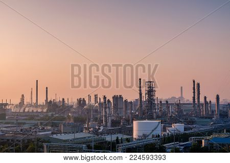 Landscape view of petrochemical industry complex with distillation tower on sunrise sky background, petroleum of fossil industrial plants