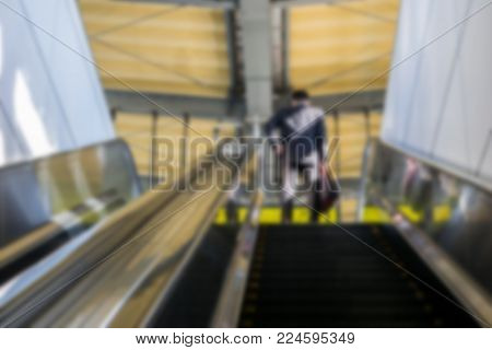 Blurry business man is walking up stairs