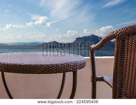 rattan chair on balcony hotel with oecan view