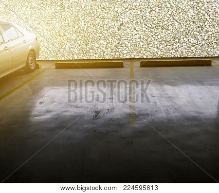 indoor empty parking car with stone wall background