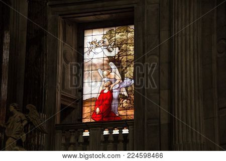 COMO, ITALY - SEPTEMBER 4, 2017: The agony of Jesus Christ in the Olive mountain (Getsemane garden), comforted by an angel. A detail of a stained glass window in the cathedral. Decorations inside the Cathedral of Como.