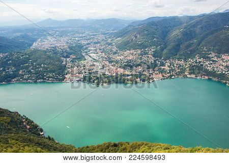 BRUNATE, ITALY - SEPTEMBER 4, 2017: Views of Lake Como from the Lighthouse Voltiano. Lighthouse named Alessandro Volta. Viewpoint of Lake Como from the top of Brunate. Como lake panorama.