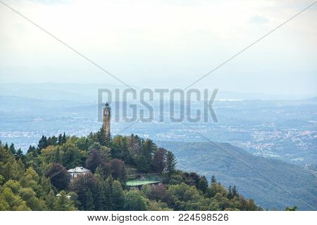 BRUNATE, ITALY - SEPTEMBER 4, 2017: Views of the Lighthouse Voltiano. Lighthouse named Alessandro Volta. View of the light house of Como. Lombardy. Italy.