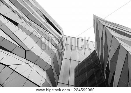 Poznan, Poland - December 31, 2017: Look up at the facade of a modern shopping center in Poznan. Architectural black and white composition.