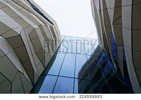 Poznan, Poland - December 31, 2017: Look up at the facade of a modern shopping center in Poznan. Architectural composition.