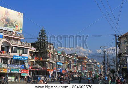 Pokhara Nepal - November 8, 2017: Unidentified People Commute In Downtown Pokhara Nepal.