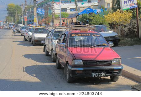 Pokhara Nepal - November 8, 2017: Unidentified Taxi Drivers Wait For Passengers In Downtown Pokhara