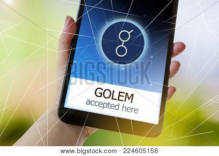 CZECH REPUBLIC, PRAGUE - JAN 31, 2018: virtual money cryptocurrency on the smartphone screen in a hand - Golem accepted here