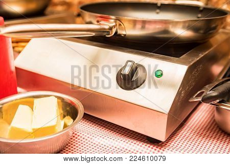 Small kitchen cooktop with frying pan close-up