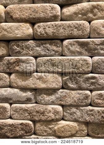 Rounded corners marbled quartz brick background photograph. Closely stacked, natural stone and colors.