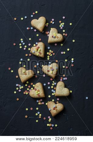 Valentine's Day cookie hearts cookies and decorations cookies on dark background, top view