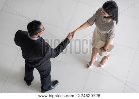 Business Team Partnership Greeting Handshake Concept.Top view.