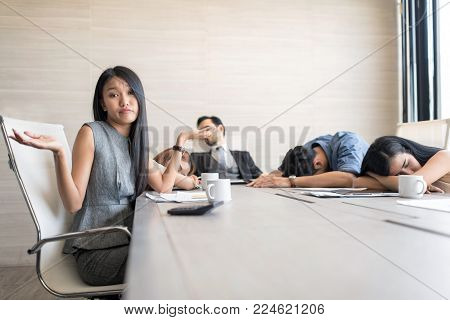 In selective focus of Business people sleeping in the conference room during a meeting.Emotional Stress, Working, Occupation concept.