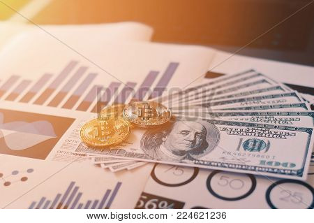 Bit coin cryptocurrency - Electronic virtual money and dollar banknote with data report background.selective focus. Risk and investment concept.