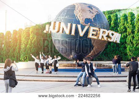 OSAKA, JAPAN - Oct 24, 2017: At the entrance with Universal Globe, there are many tourists to visit Universal Studios Japan famous amusement park, Osaka city.