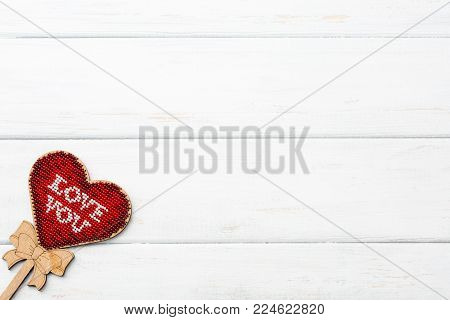 The model hart shape red color inside lay down on white wooden surface. Valentine's Day. Copy space