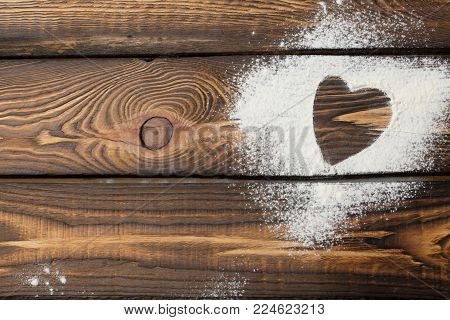 heart free space. Heart made of flour on a wooden background. Valentine's Day