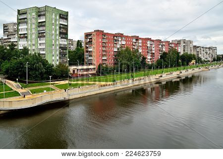 Kaliningrad, Russia - 18 August 2016: townspeople walk through new quay on the street of Admiral Tributs on the banks of the Pregolya river
