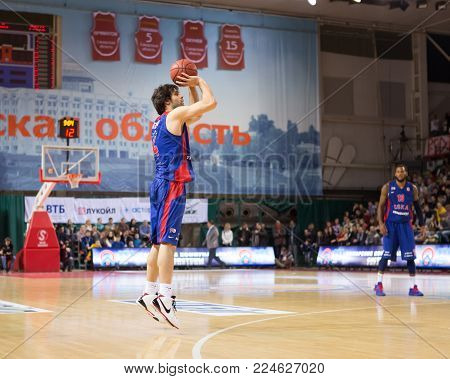 SAMARA, RUSSIA - DECEMBER 01: BC CSKA guard Milos Teodosic (4) shoots 3-point shot during the BC Krasnye Krylia game on December 01, 2013 in Samara, Russia.