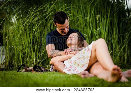Romantic young smiling couple gazing at each other