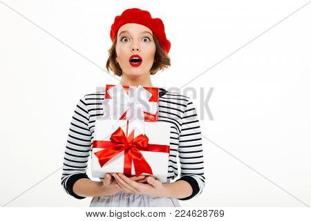 Photo of young surprised lady isolated over white background wall holding gift surprise box.