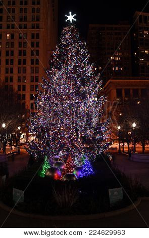 Giant Huge Christmas Tree adorned with Red, Green and Blue Christmas Lights and star on top in Millennium Park, Chicago, IL, December 5th, 2017