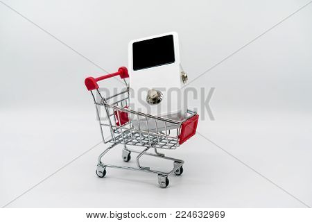White guitar pedal and red shopping cart isolated on white background