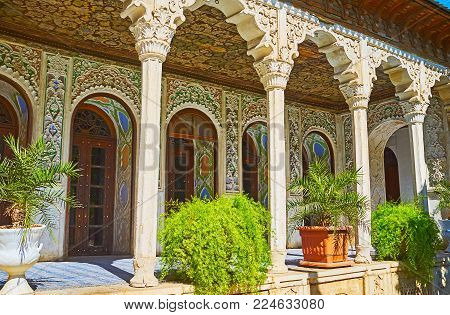 Shiraz, Iran - October 12, 2017: The Shady Gallery In Zinat Ol-molk Mansion Decorated With Carved Pl