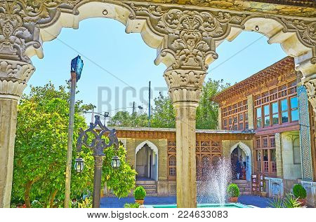 Shiraz, Iran - October 12, 2017: The View On Zinat Ol-molk Mansion Through The Arches Of Its Gallery