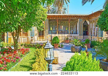 Shiraz, Iran - October 12, 2017: The Beautiful Shady Garden Of Zinat Ol-molk Complex Is The Best Pla