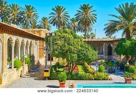 Shiraz, Iran - October 12, 2017: The Scenic Garden Of Historic Zinat Ol-molk Mansion With Colorful F