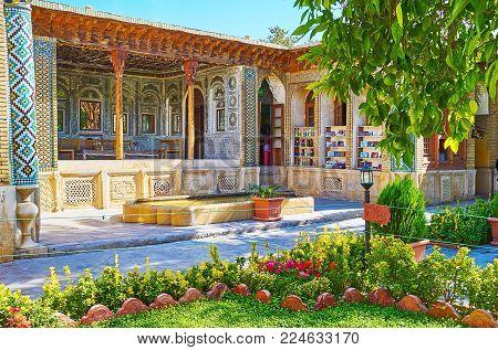 Shiraz, Iran - October 12, 2017: The View Through The Greenery Of Garden On The Medieval Mirror Vera