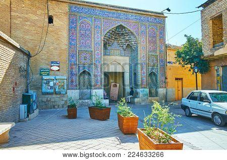 SHIRAZ, IRAN - OCTOBER 12, 2017: The  narrow street leads to the scenictiled facade - the entrance to the famous Nasir Ol-Molk mosque, on October 12 in Shiraz.