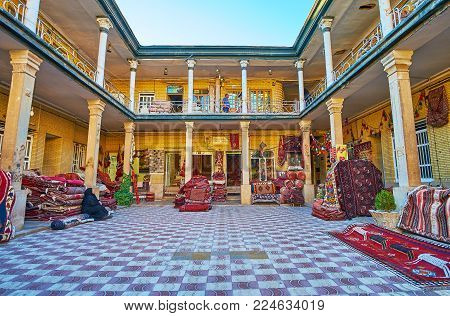 Shiraz, Iran - October 12, 2017: The Courtyard Of Carpet Market With Kilims And Rugs, Lying On The F