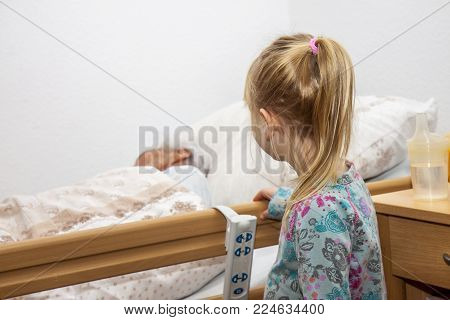 Little girl visiting her dying great grandma