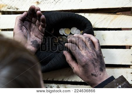The Beggar Considers Coins.