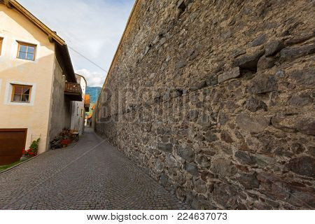 SOUTH TYROL, ITALY : SEPTEMBER 2017 - The existing city wall in Glurns, South Tyrol, Italy on September 28, 2017. Built by Emperor Maximilian as defensive walls against Swiss incursions