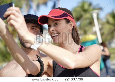 Couple of joggers in Miami beach taking selfie pictures