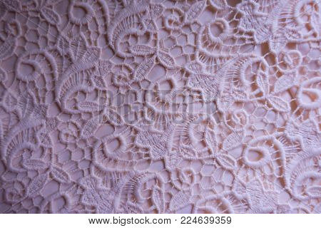 Pink lace with floral pattern from above