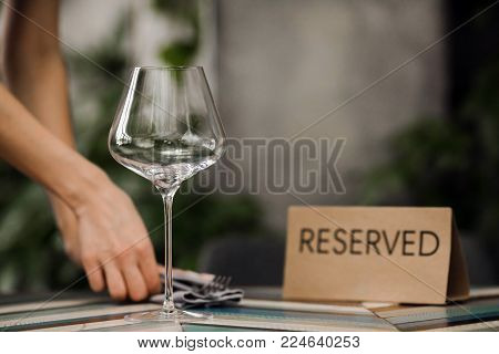 Reserved table with a plate and an empty glass in the cafe