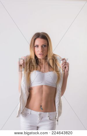 Fashion Editorial Shot In Studio With White Background. Beautiful Model Posing In Total White Clothe