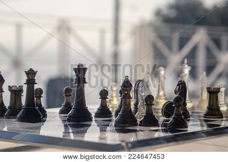 Glass chess on the board near the terrace with a view to the sea